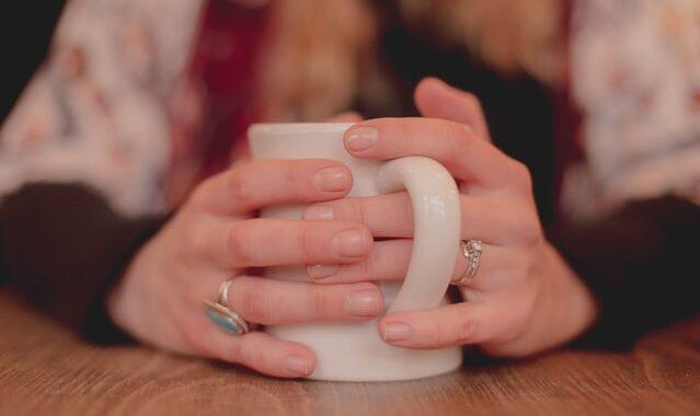 Hands around a mug